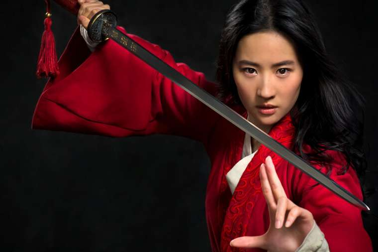Mulan holding a sword in movie promo