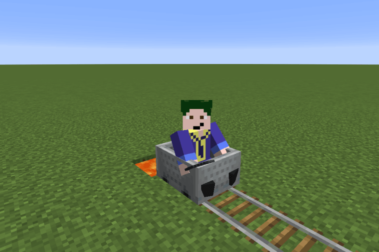 Barish about to fall into lava while riding a minecart.